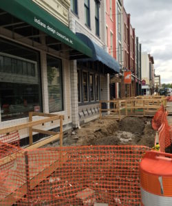 Sidewalk removal underway on north side of Main Street between 4th and 5th